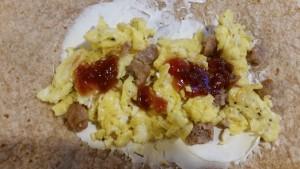 egg and cream cheese breakfast burrito inside